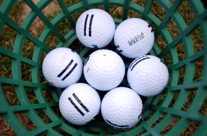 02-12-04, Tuscaloosa, Ala..,  Golf balls at Ol Colony Golf Course on Watermelon Road Thursday afternoon. (Tuscaloosa News/Jason Getz)