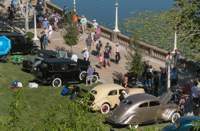 Automobile enthusiasts view the classic cars on display along the Frances Langford Promenade at Lake Mirror during the 2018 MidFlorida Auto Show & Lake Mirror Concours in downtown Lakeland. The show was canceled for 2020 and MidFlorida Credit Union has announced it will no longer host the event.