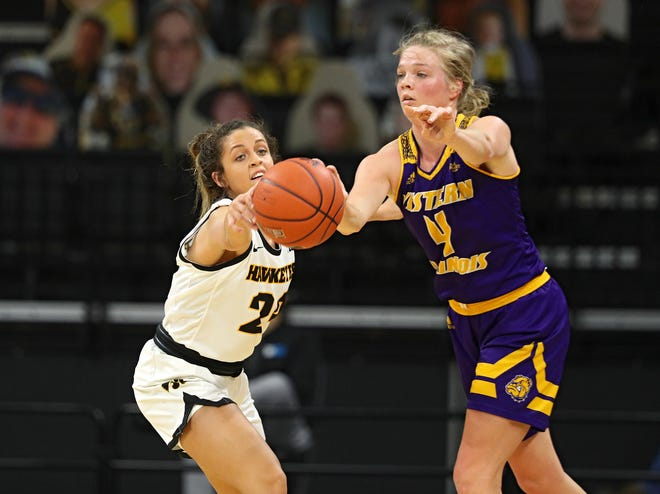 Iowa Hawkeyes guard Gabbie Marshall (24) steals a pass away during the second quarter of their game at Carver-Hawkeye Arena in Iowa City, Iowa on Tuesday, December 22, 2020. (Stephen Mally/hawkeyesports.com)