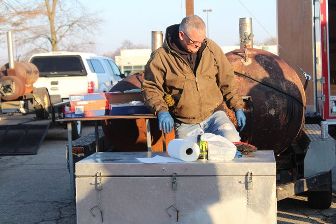 A volunteer is seen during the Macomb VFW food giveaway.