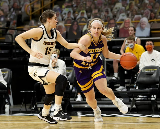 Western Illinois Leathernecks guard Anna Deets (33) drives to the hoop against Iowa Hawkeyes guard Lauren Jensen (15) Tuesday, December 22, 2020 at Carver-Hawkeye Arena. (Brian Ray/hawkeyesports.com)