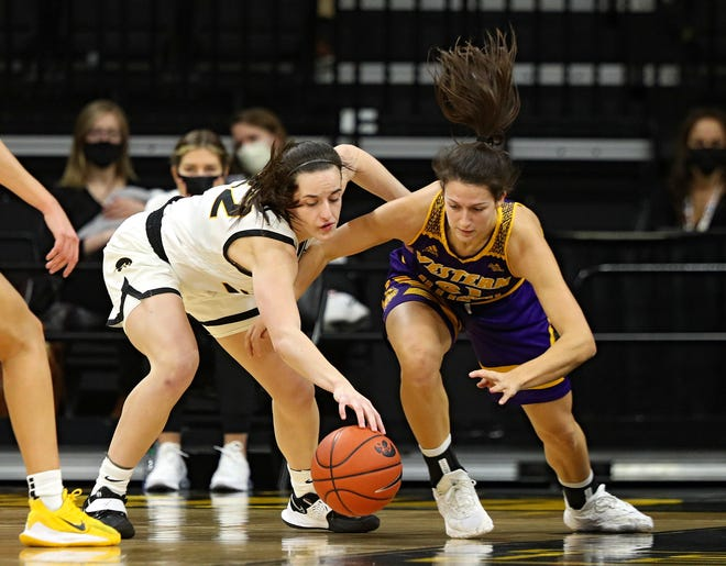 Iowa Hawkeyes guard Caitlin Clark (22) and Western Illinois Leathernecks guard Grace Gilmore (21) battle for the ball during the first quarter of their game at Carver-Hawkeye Arena in Iowa City, Iowa on Tuesday, December 22, 2020. (Stephen Mally/hawkeyesports.com)