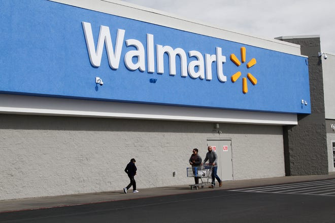 People shop at a Walmart Thursday, Feb. 6, 2020, in El Paso, Texas. The Justice Department is suing Walmart, alleging the company unlawfully dispensed controlled substances through its pharmacies, helping to fuel the opioid crisis in America, a person familiar with the matter told The Associated Press. The civil complaint being filed Tuesday, Dec. 22, 2020 points to the role WalmartÕs pharmacies may have played in the crisis by filling opioid prescriptions and by unlawfully distributing controlled substances to the pharmacies during the height of the opioid crisis, the person said. (AP Photo/Cedar Attanasio)