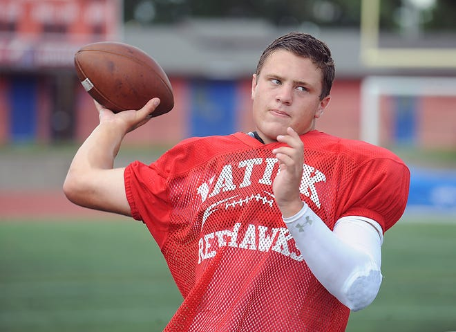 Natick High quarterback Will Lederman, pictured as a junior, throws a ball at practice last season.