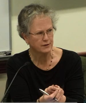 Terri Evans, chairwoman of the Natick Planning Board, announced in open meetings held by the board that it would not publicly release a legal opinion from the town's lawyer. A lawyer with the Massachusetts Bar Association questions the board's decision.