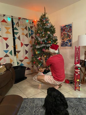 Daily News Sports Editor Seth Stringer decorates his house during the holidays.