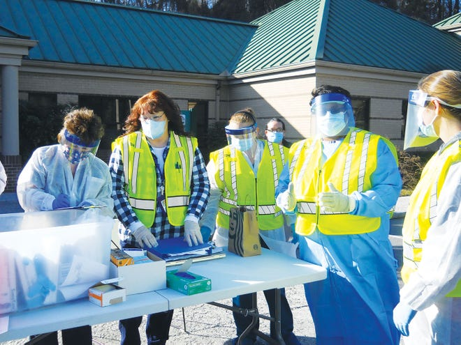 Ben Pounds/The Oak Ridger Workers outside the Anderson County Health Department — Gail Baird, from left, Phyllis Goodman, Jasmine Jones, Melissa Casada, Donna Farmer and Sarah Hogan prepare to vaccinate other health professionals.
