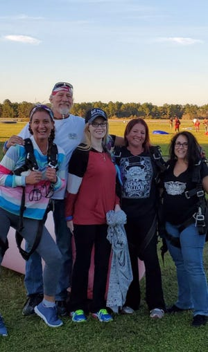 Hope Hill, third from left, went skydiving earlier this month to celebrate the second anniversary of her five-organ transplant. The other people pictured are, left to right, Jennifer Wilson, Todd Davis, Kelly Osborn and Anna Hughes.