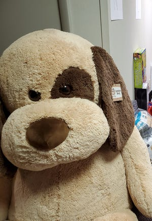 A lucky child received a teddy bear for Christmas as part of a toy drive sponsored by the Pleasant Valley Ecumenical Network's Christmas toy program.