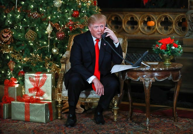 President Donald Trump and First Lady Melania Trump participated in NORAD Santa Tracker phone calls from Mar-a-Lago in Palm Beach on Dec. 24, 2017.