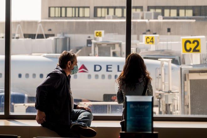 Holiday travelers wait for flights inside Palm Beach International Airport in West Palm Beach, Florida, on December 18, 2020.   [RICHARD GRAULICH/palmbeachpost.com]