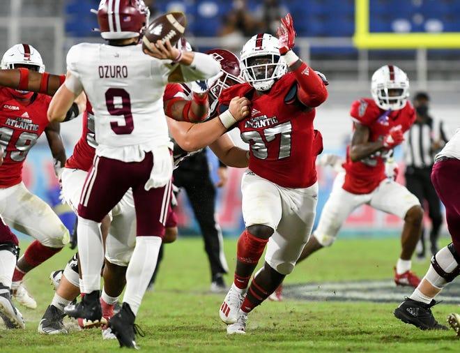 Florida Atlantic defensive lineman Alvin Dempsey, pressuring UMass quarterback Garrett Dzuro during the Owls' win last month, will have to put similar heat on Memphis quarterback Brady White.
