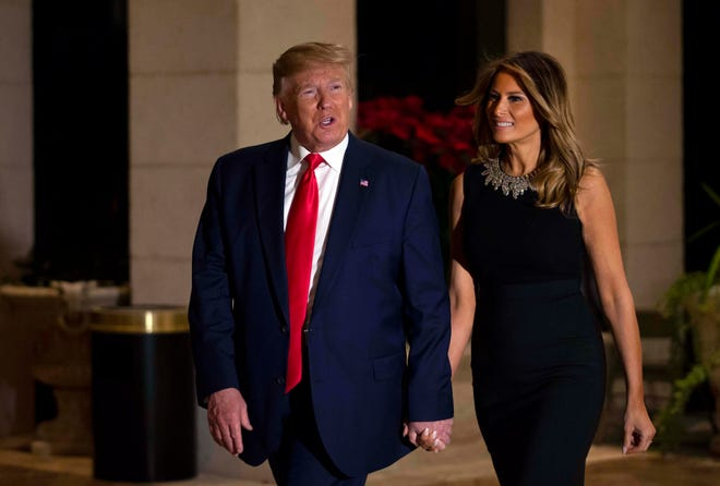 President Donald Trump and first lady Melania arrive for Christmas dinner at the ballroom at Mar-a-Lago in Palm Beach, Dec. 24, 2019.