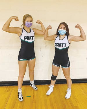 Pratt wrestlers Livia Swift (left) and Jadyn Thompson (right) are showing their strength on the mat as well as for pictures, each undefeated in their invidual weight classes thus far into the winter season.