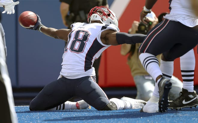 New England Patriots' Matthew Slater celebrates his touchdown after recovering a blocked punt against the Buffalo Bills in a game played last September. On Monday, Slater was named to the AFC Pro Bowl team.