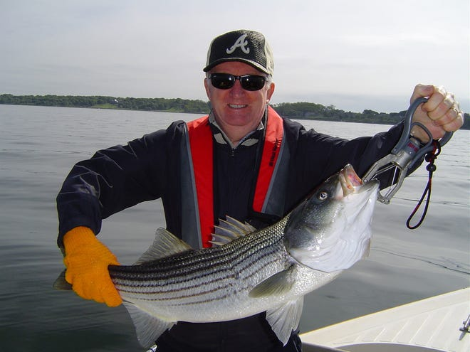 Ed Langon, a former Rhode Island resident now living in California, caught this striped bass using a tube and worm rig. Circle hooks may now be required to be used on the rig unless anglers are able to persuade regulators to consider an exemption.