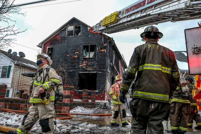 Two young girls were pulled unconscious from a three-alarm fire that destroyed their Providence home Tuesday. One died at the hospital. The fire raced through a multifamily house at 10 Lucy St., in the Mount Pleasant neighborhood. The fire spread to houses on both sides.