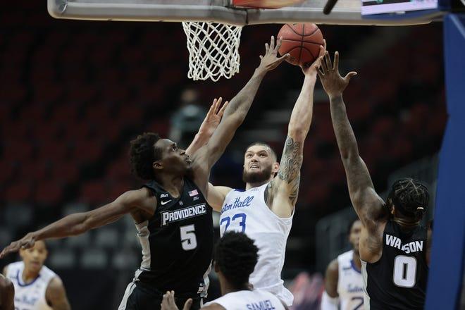 Providence's Jimmy Nichols Jr. (5) and Nate Watson (0)  defend Seton Hall's Sandro Mamukelashvili on Sunday at the Prudential Center in Newark, N.J.