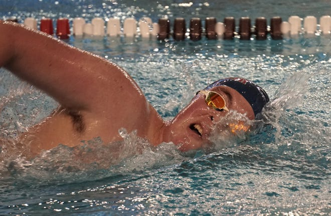 John Gilpin of Portsmouth High School swims in last year's state swimming championships at Brown University. High School swimming is on track to begin in January.