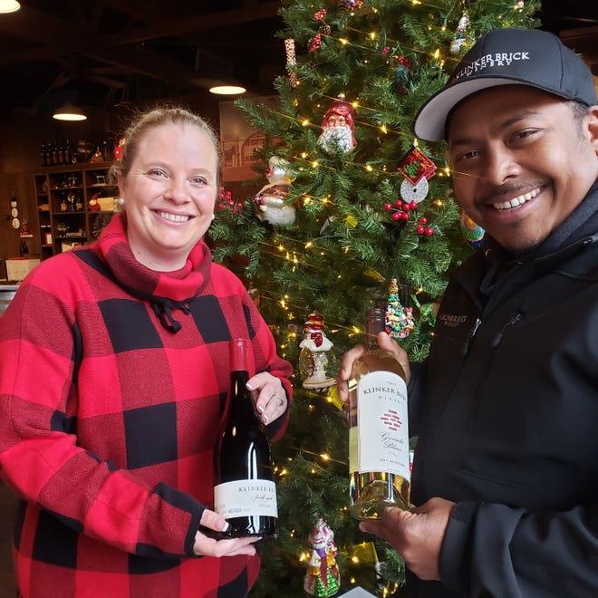 Farrah Felten-Jolley, left, holds Klinker Brick's award-winning 2016 Farrah Syrah, and winemaker Joseph Smith holds a bottle of the 2019 Grenache Blanc, which made Wine Spectator's Top 100 list this year.