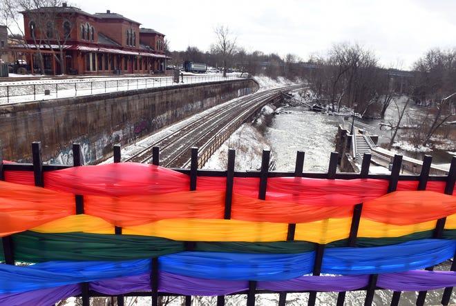 A rainbow flag hangs on the Main Street Bridge in Kent in 2020 for Rainbow Weekend.