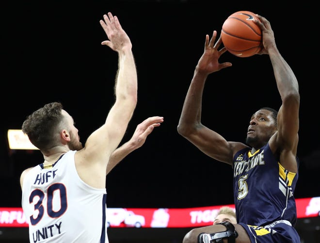 Kent State senior forward Danny Pippen shoots over Virginia's Jay Huff during a game played earlier this season at John Paul Jones Arena in Charlottesville, Va.