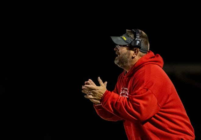 Canton South head couch Greg Reed encourages his players during the Wildcats game against the Marlington Dukes, Friday, Oct. 18, 2019.