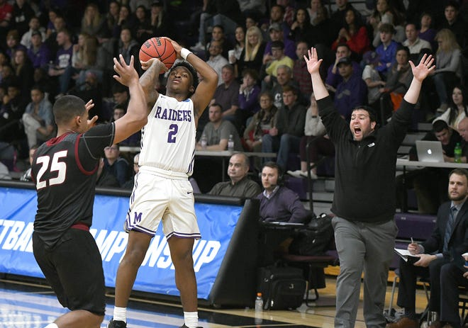 Mount Union sophomore Collen Gurley hits one of his eight first-half 3-pointers against Cairn in a NCAA Division III regional tournament first-round game, March 6, 2020. (CantonRep.com / Ray Stewart)