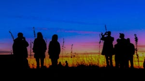 People of all ages gathered Monday evening at the top of Coronado Heights to observe the alignment of the planets Jupiter and Saturn. The last time the planets aligned this closely was 1226.