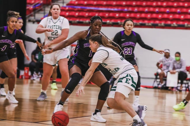 Lady Texans try to guard against Eastern Michigan on Monday afternoon in Las Vegas. Despite a second-half comeback, the Texans fell to Eastern Michigan, 65-59.