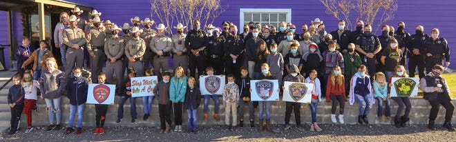 On Dec. 21, law enforcement from all Erath County agencies met to participate in the first Shop with a Cop event. Nearly 40 local kids first met with officers for breakfast at the Purple Goat and were then taken via marked units lights and sirens to Wal-Mart. There, each kid was personally escorted by an officer to shop for Christmas presents. The community raised more than $12,000 for the event and it was a huge success. For more photos from this event, see page A8.