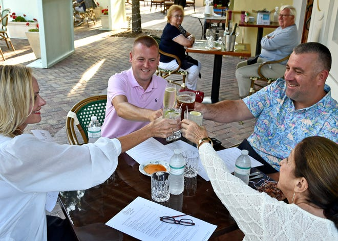 Patti Tebo, far left, Jeremy Wright, Andrew Basco and Lynn Weatherly, all of Sarasota, are seen dining at Rosemary & Thyme on May 8. Rosemary & Thyme is among the Sarasota-Manatee restaurants that will be open on New Year's Eve.