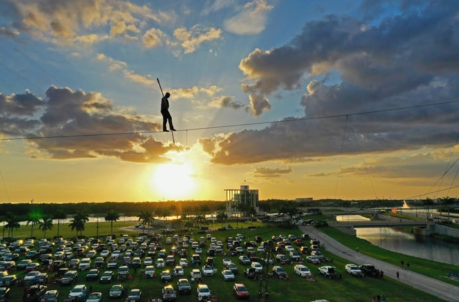 """Nik Wallenda performs at an event billed as """"the world's first drive-in stunt show,"""" on Friday, June 12, 2020. Wallenda is set to perform Aug. 16 at Battle Creek's FireKeepers Casino Hotel to celebrate the opening of its second hotel tower."""