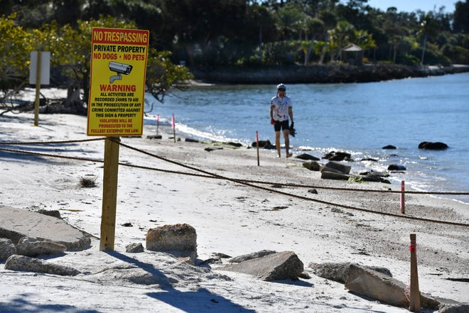 """Last year, a Siesta Key property owner erected a """"No Trespassing"""" sign and a barricade of concrete rubble and ropes along a popular public beach access on Siesta Key to discourage the public from walking on the beach in front of his house."""