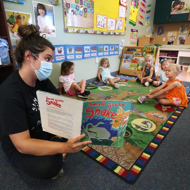 St. Mark's preschool teacher Holly Fraize has story time with the three-year-old class on Thursday, Sept. 17, 2020 in Venice. Herald-Tribune photo / Matt Houston