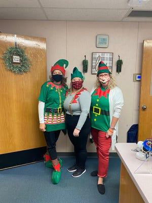 Horace Mann Elementary School employees dressed aelvesto celebrate the holidays.