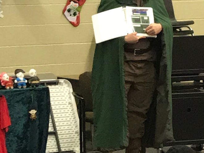 North Rock Creek Public Schools custodian and graphic novelist Charles Curry giving his yearly comic book presentation to students. Provided photos.