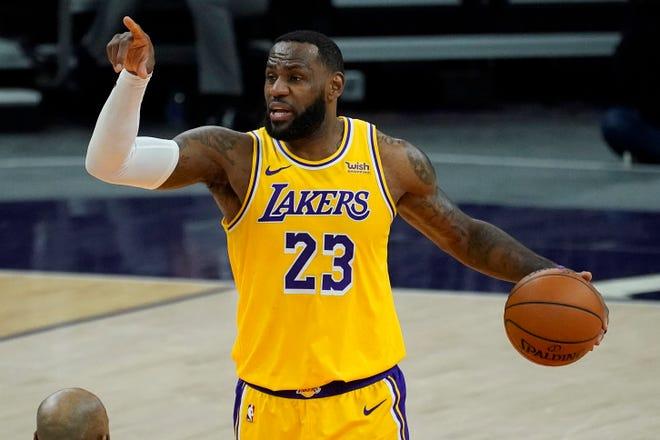 Los Angeles Lakers forward LeBron James (23) calls a play in a preseason game on Dec. 18 in Phoenix, Ariz.