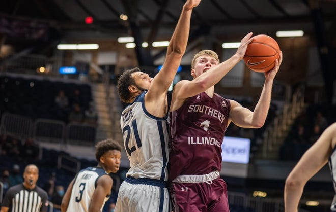 Marcus Domask  of Southern Illinois drives on JaKobe Coles of Butler on Monday at Hinkle Fieldhouse in Indianapolis, Indiana.