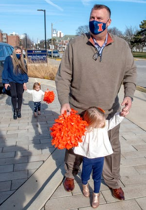 University of Illinois' new football coach Bret Bielema and his family, wife Jen and daughters Briella, front, and Brexli were introduced to the media outside the Smith Center on UI campus in Champaign, Ill. on Monday.