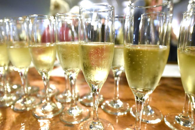 Champagne toasts will flow at local restaurants this New Year's Eve. [KEN BLEVINS/STARNEWS]