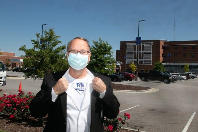 Vice president of nursing Jim Davis shows off his superpower. [Bill Hand / Sun Journal Staff]