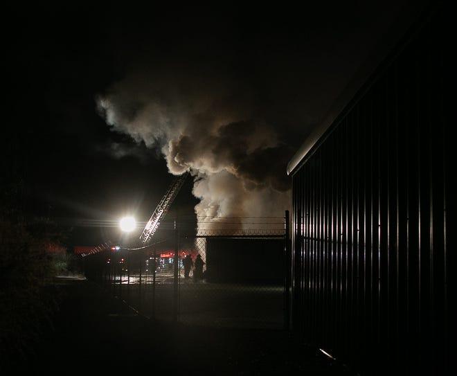 Firemen battle a blaze at United Storage. [Bill Hand / sun Journal Staff]