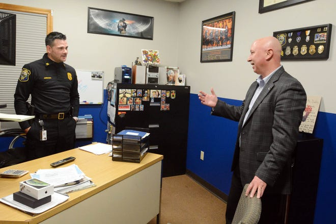 Plainfield Police Chief Michael Surprenant, right, who is retiring January 31st after 25 years on the Plainfield force and nine as chief talks with Captain Mario Arriaga Monday. [John Shishmanian/ NorwichBulletin.com]