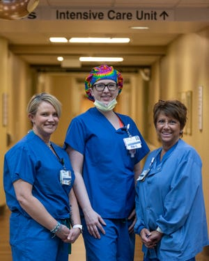 From left, Sara Carson, Michelle Spencer and Tammy Meeka, all registered nurses, stand inside the courtyard at University of Kansas Health Systems St. Francis Campus. They work in intenstive care.