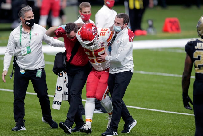 Kansas City Chiefs running back Clyde Edwards-Helaire (25) is helped off the field after being injured in the second half of an NFL football game against the New Orleans Saints on Sunday in New Orleans.