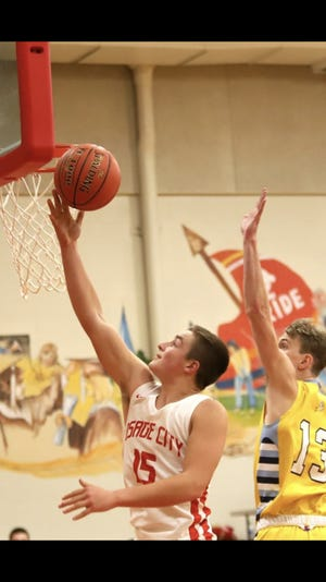 Osage City sophomore Landon Boss goes in for a layup for two of his career-high 36 points last Tuesday against Central Heights. Boss averaged 29 points per game in two Indian wins, earning area athlete of the week honors.