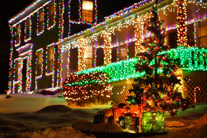 HUBBARDSTON - Holiday lights on Worcester Road home in the center of town. Residents engaged in the annual Light Fight, a friendly competition in which they try to best one another with excessive holiday displays.