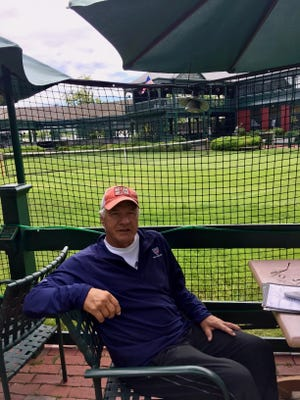 Tommie George relaxes at the International Tennis Hall of Fame in Newport.