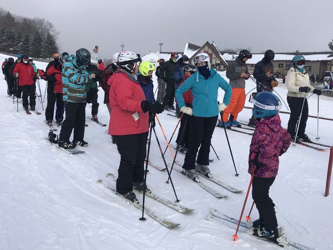 Wachusett Mountain skiers wait in lines on Monday.